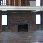 Uncovering the Mezzanine and fireplace in the future dining