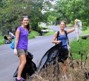 Students at the Center  in Costa Rica cleaning up trash along the road in the community on a Saturday morning to prove that we are not just typical American tourists.  We want to involve ourselves, help out the locals, and learn from our hard work and commitment to make a difference.