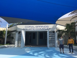 Entrance to the Choral Springs Aquatic Center in Choral Springs Florida. To the right in the gray shirt is head coach Kirk Kumbier.