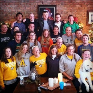 The Allegheny Swimming and Diving Team at a team members house on the way home from Florida training trip.