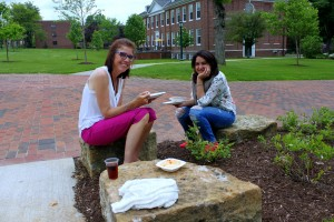 Natasha and Christine enjoying lunch outside after working hard on their posters