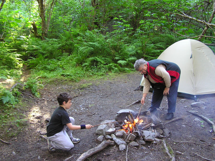 Zach and grandma roasting marshmallows on the Kenai Peninsula