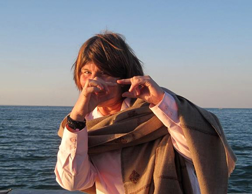 Cheryl Hatch poses for a photo on the corniche in Kuwait City in January 2012.