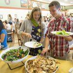 Students enjoying local food