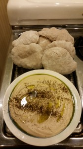 Sue's hummous accompanied by pitas made from a Saudi Arabian sourdough.