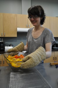 Cara Brosius '16 helps to cook one of the food co-op group's Friday night dinners.